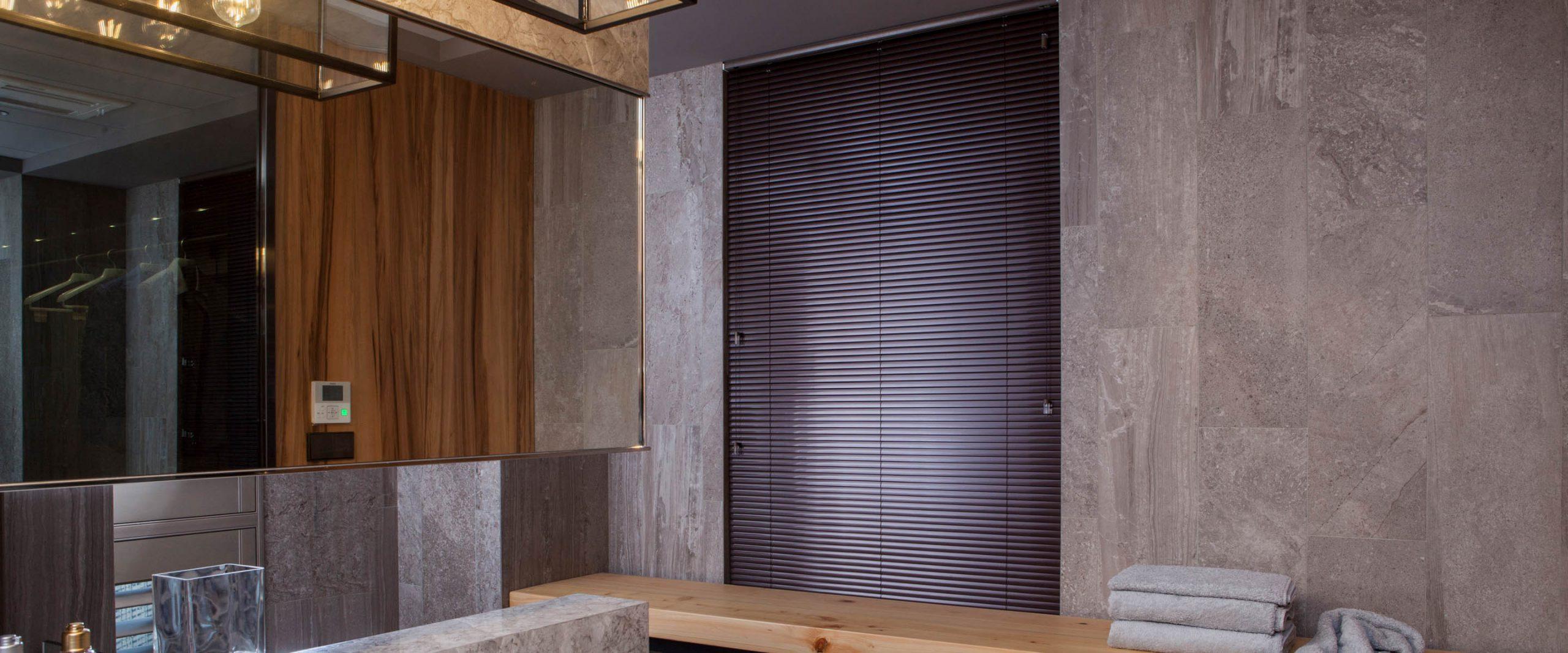 aluminum blinds against concrete wall