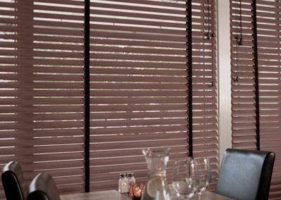 brown aluminum blinds in conference room