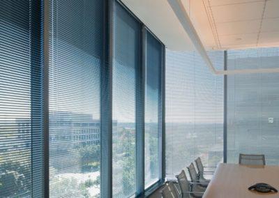 aluminum blinds on full windows in a loft