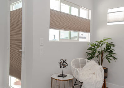 Small window with cellular and pleated shades