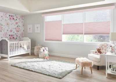 Nursery with pink cellular and pleated shades