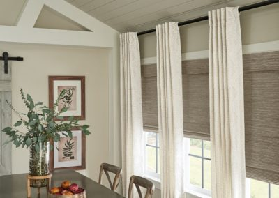 woven blinds and drapes in dining room