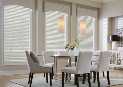 short drapes in dining room with blinds