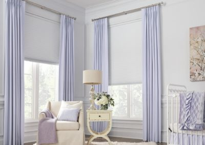 lilac drapes with modern roller shades in beachy living room