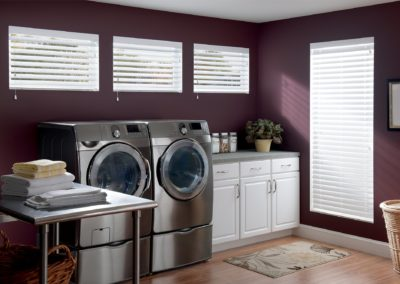 short windows with blinds in laundry room
