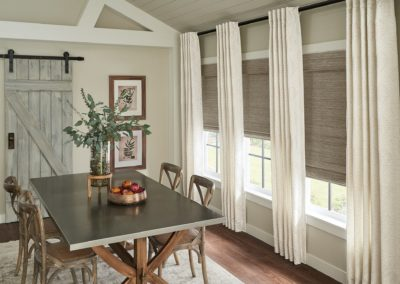 Dining room with natural woven shades