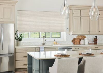 Kitchen with natural woven shades