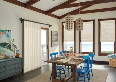 Room with three natural woven shades