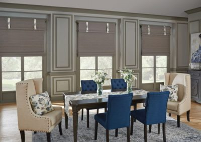 Dining room with grey natural woven shades