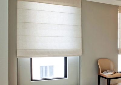Waiting room with roman shades