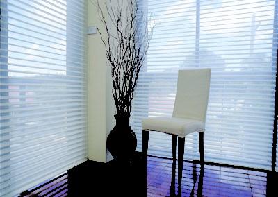 Tall windows with sheer shades