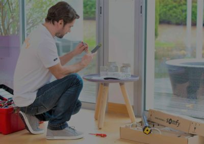 man controlling automation blinds