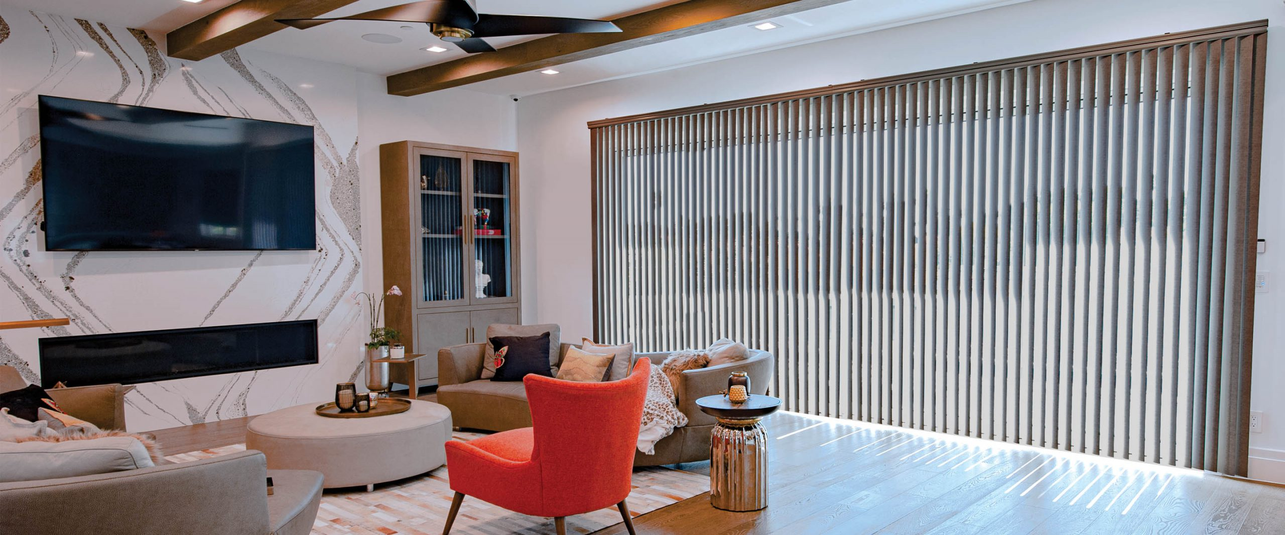 vertical blinds in modern living room with orange chair