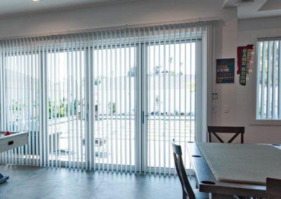 vertical blinds in kitchen against sliding doors