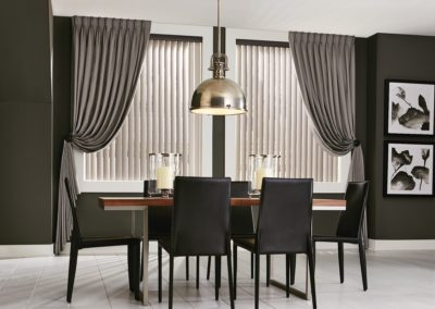 vertical blinds in dining room with curtains