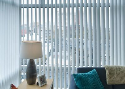classic white vertical blinds in ofice